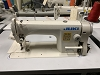 Juki DDL-8700 Industrial Sewing Machine, compete with table and motor.